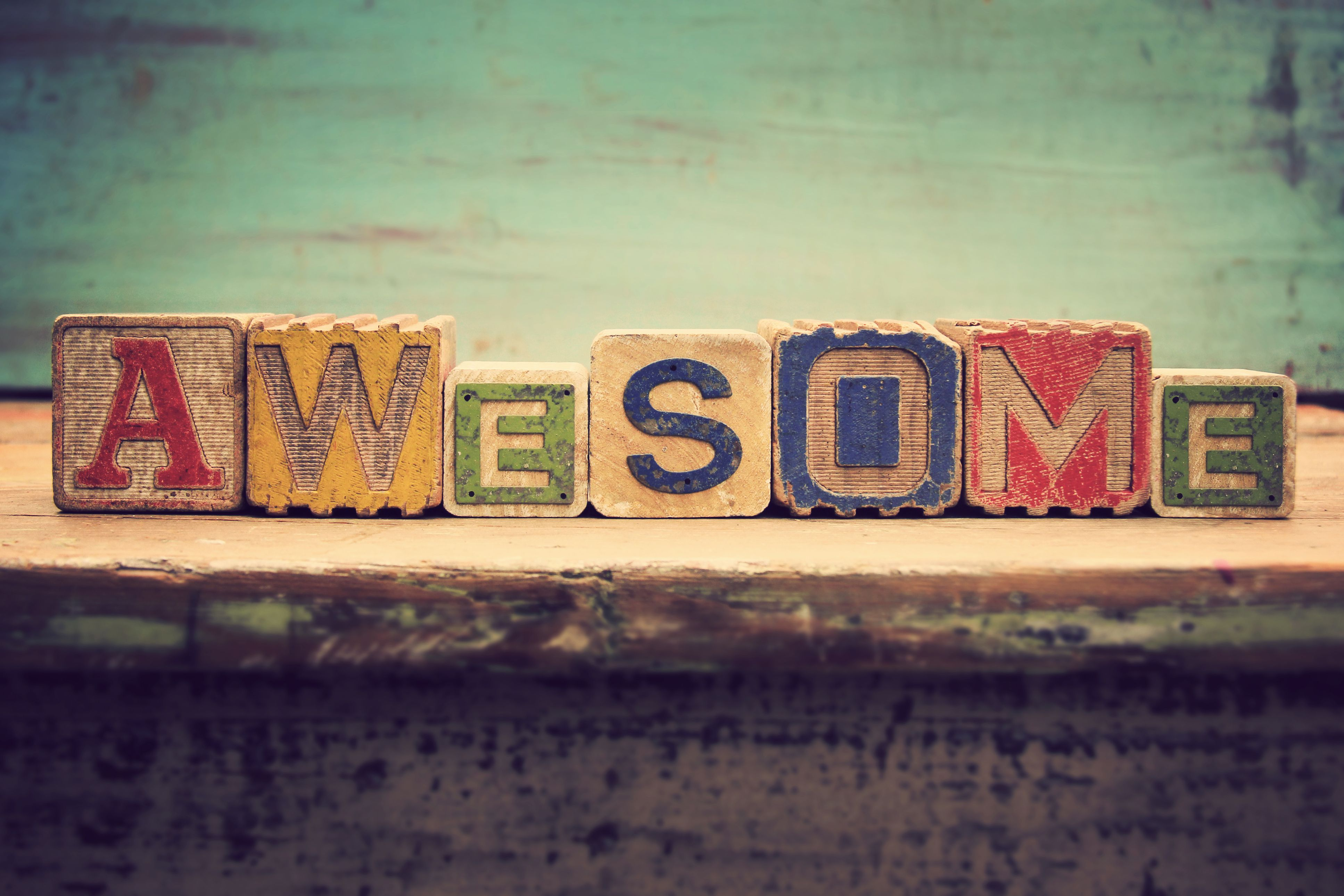 """Toy wooden blocks that read """"awesome"""""""