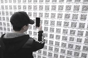 Man scanning codes with his smartphone.