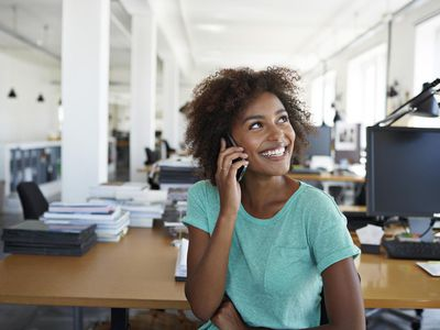 Portrait of girl laughing in creative office