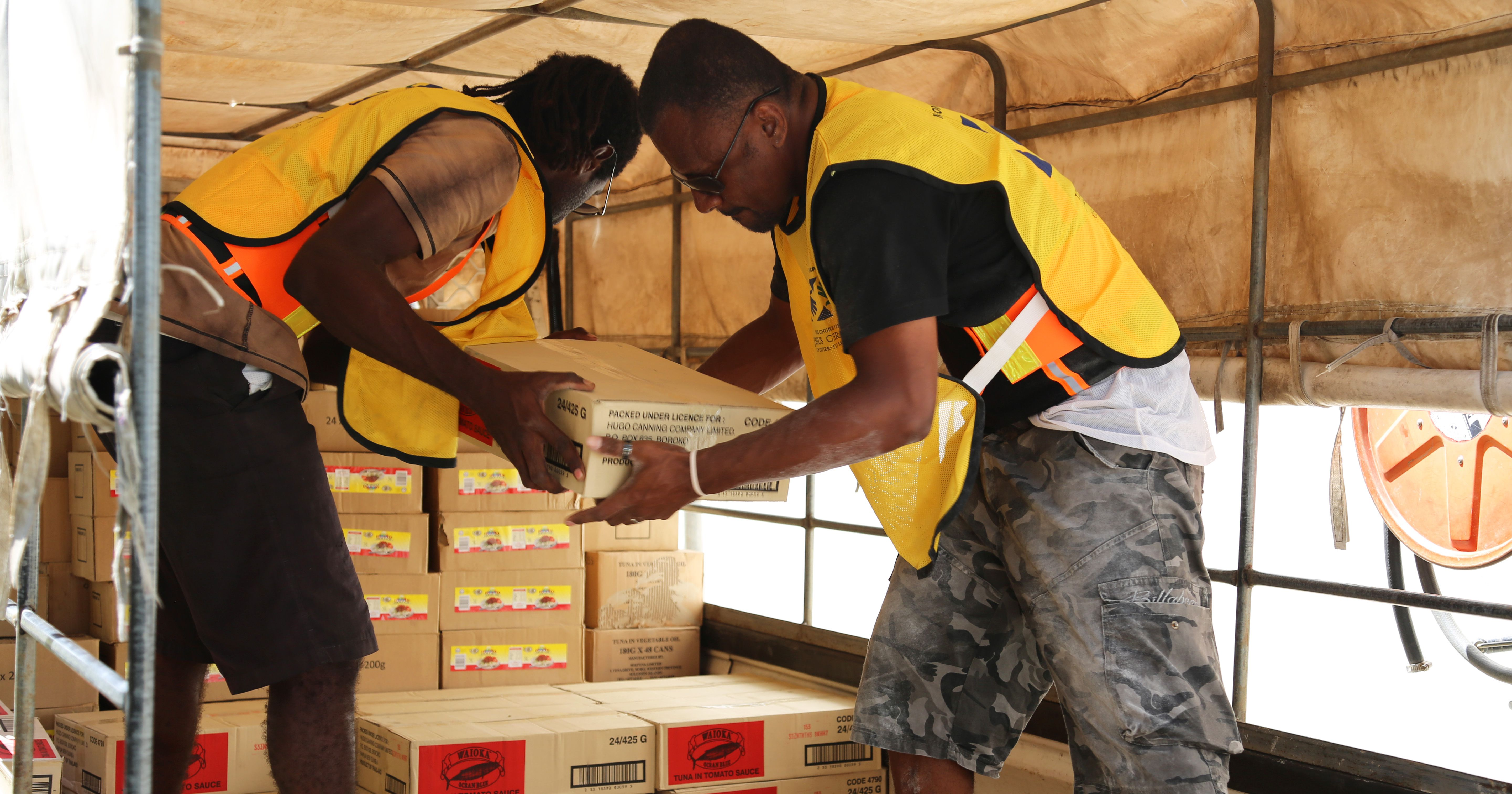 Two men assisting with disaster relief