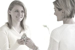 Teenager handing money to mother