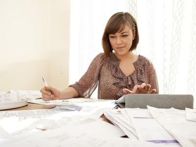 Woman calculating receipts for taxes