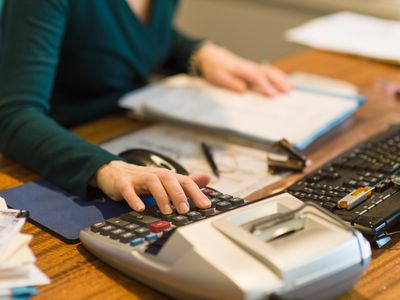 Small business owner working on bookkeeping tasks