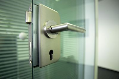 Close up of a door handle with a keyhole.