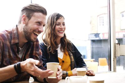 Two happy customers drinking coffee