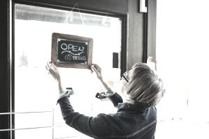Woman opening her store