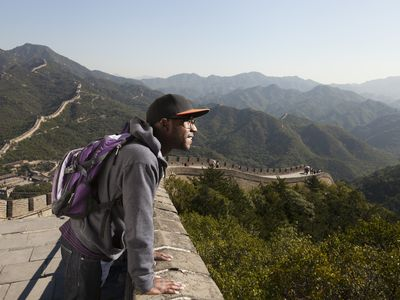 Man enjoying the view from the Great Wall of China