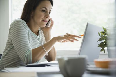 woman on the phone and computer