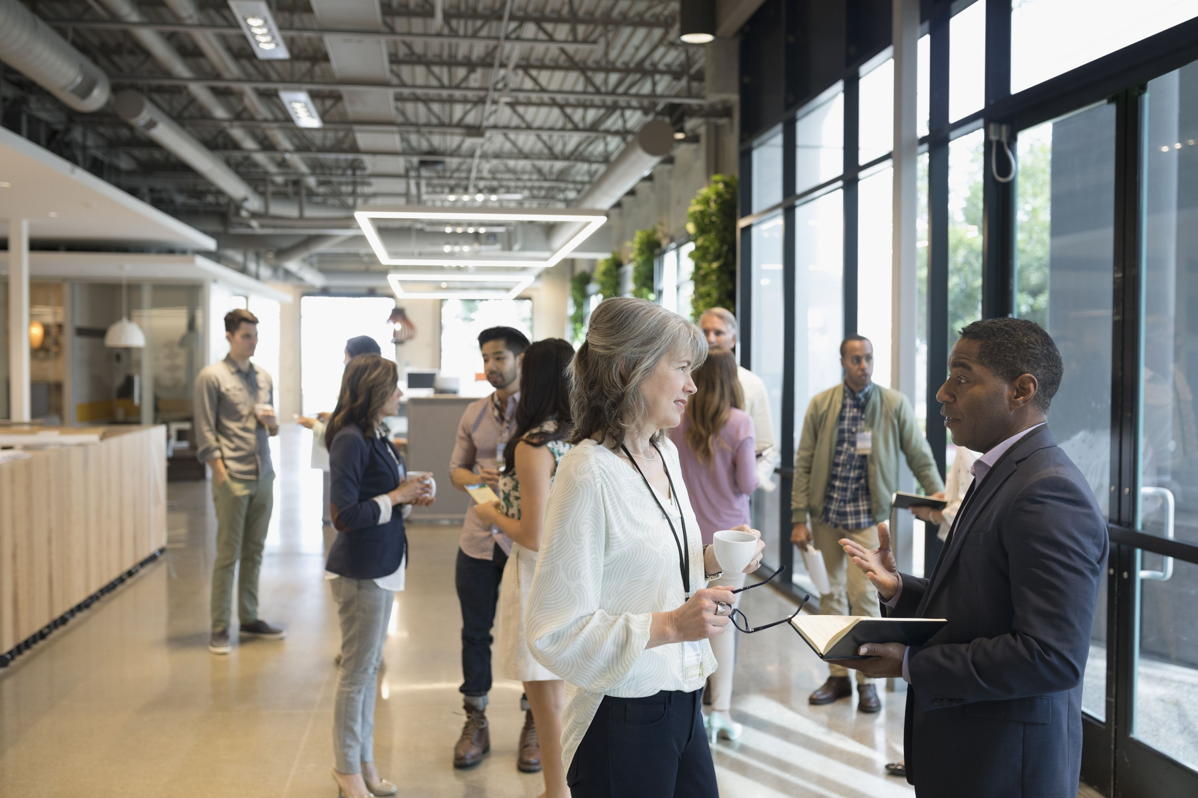 Business people mingling in office lobby