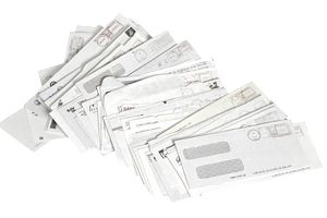 a stack of opened business envelopes