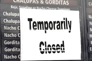 Sign on business stating it's temporarily closed