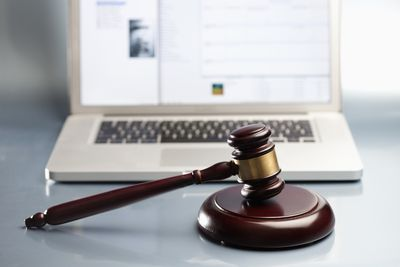Gavel in front of a laptop