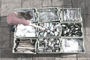 Woman sorting recyclables into separate bins.