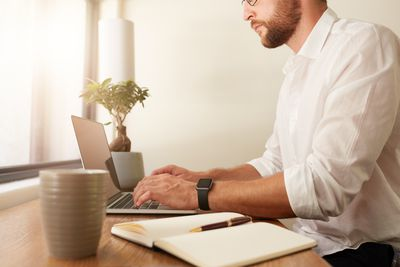 Businessman at home office working on laptop