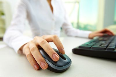 woman clicking a computer mouse