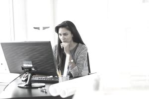 Woman working on desktop computer