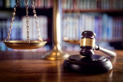 Judges gavel and justice scales weigh vicarious liability