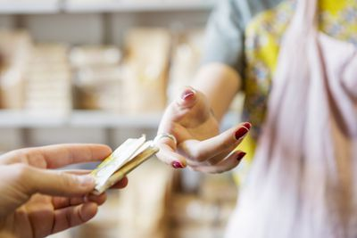 Business owner accepting payment from customer