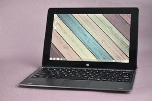 An open laptop computer with a colorful desktop background.