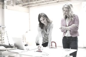 two business women looking at papers in an office
