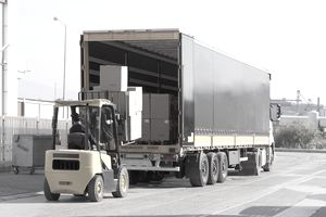 forklift loading boxes from a truck