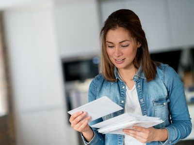 Woman looking at her mail.