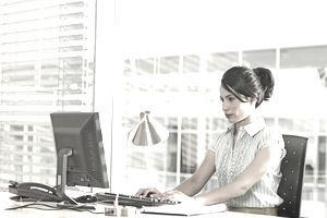 data entry clerk typing at computer