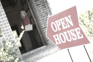 Realtor Opening Door at an Open House