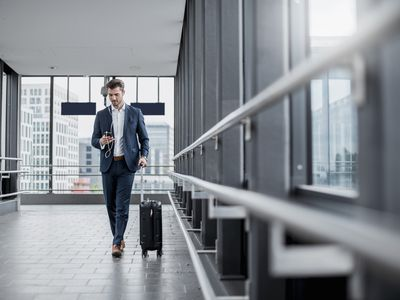 businessman in an hotel passageway with luggage