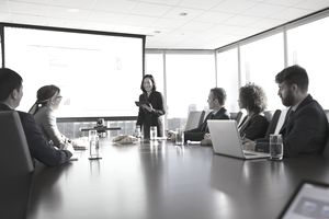 Woman giving presentation at a business meeting