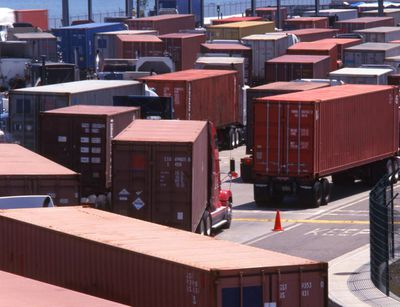 Trucks in queue at shipping terminal, Port of Los Angeles, California, United States