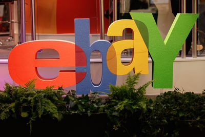 large three dimensional ebay sign with plants in front of it