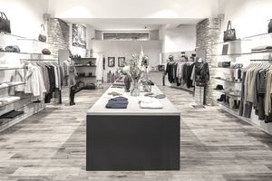 Interior of a modern concept store, displaying fashion