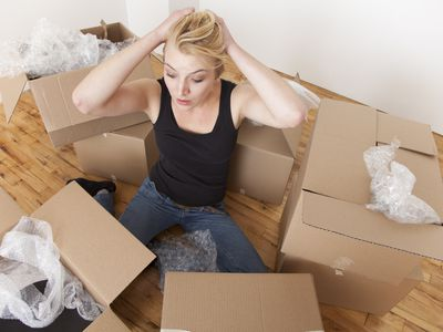 Caucasian woman packing boxes