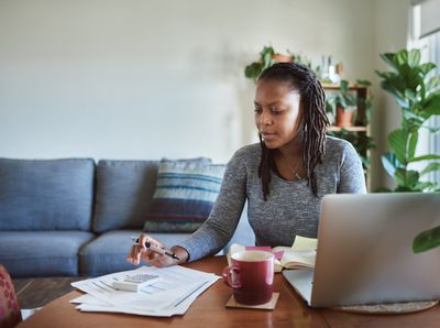 Woman financial planning and filing taxes with laptop