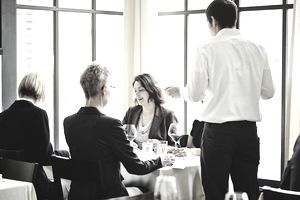 A group of businesswomen meeting in a restaurant