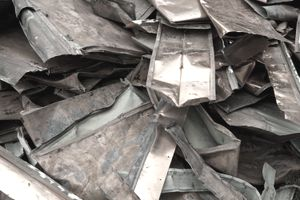 A pile of scrap copper roofing being collected for recycling.