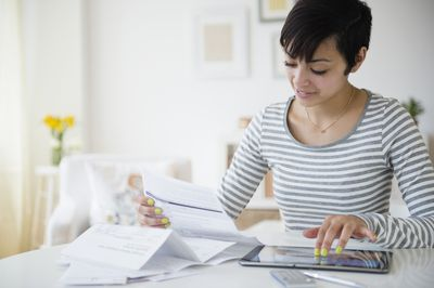 Young woman doing accounting