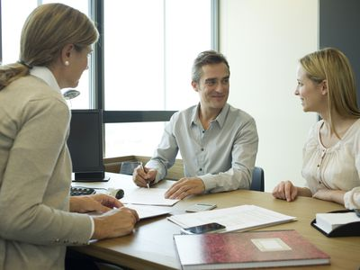 Two business owners meeting with finance office to submit business loan proposal