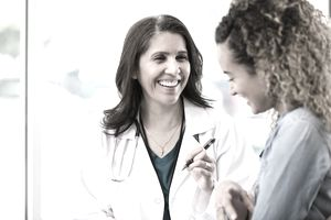 Doctor shares good news with patient