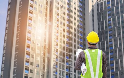 how to successfully bid commercial construction jobs construction engineer at large condominium building site