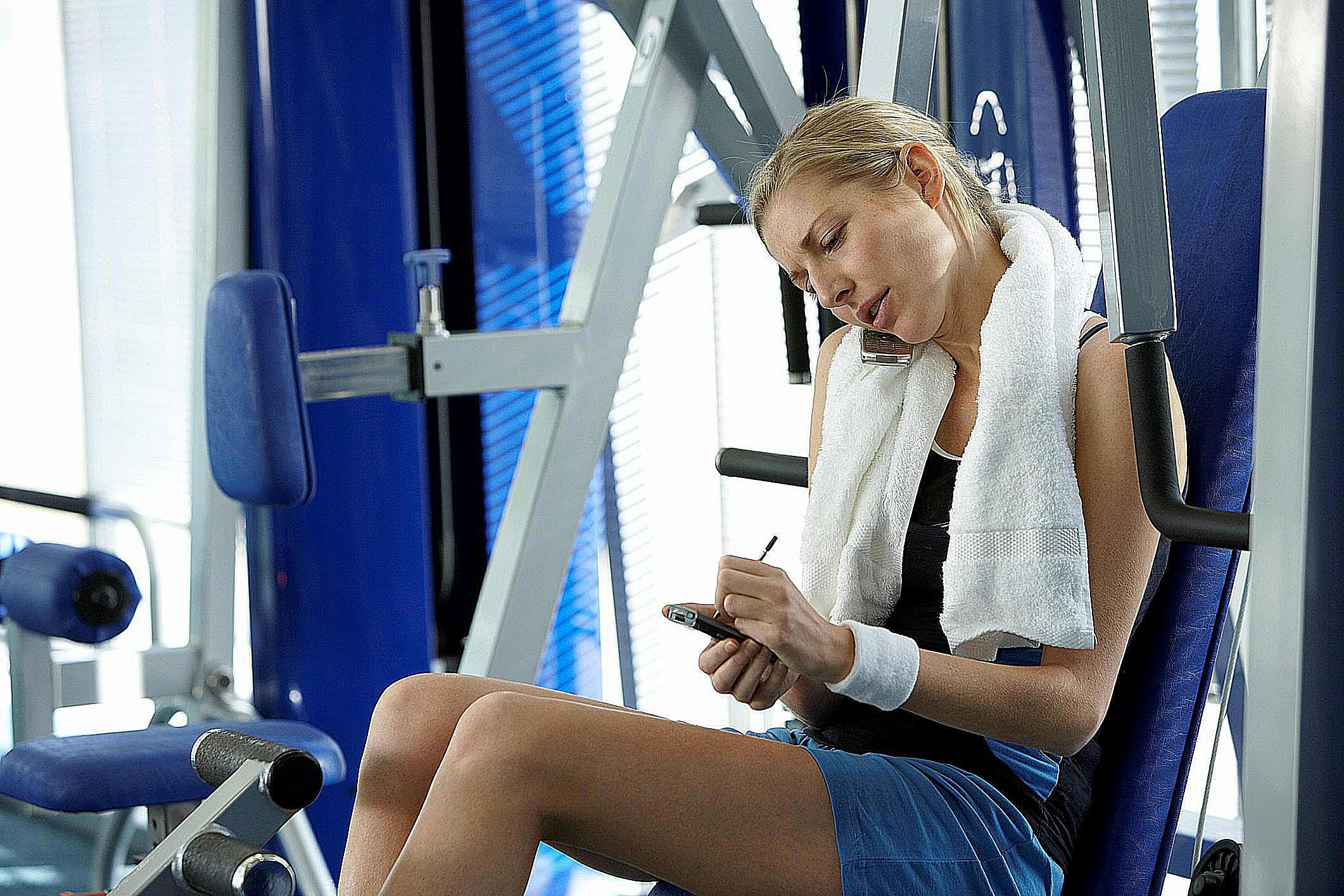 Woman working out on equipment at the gym