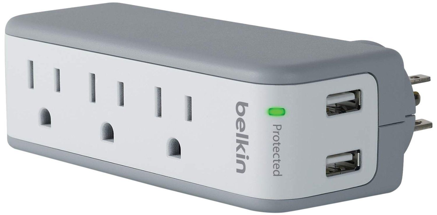 Closeup of a white and gray surge protector