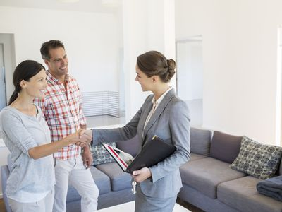 Couple meeting with a property manager to view a rental property.