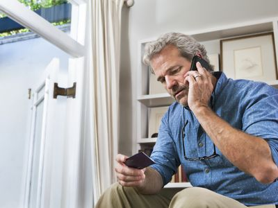 Man buying on the phone with a credit card