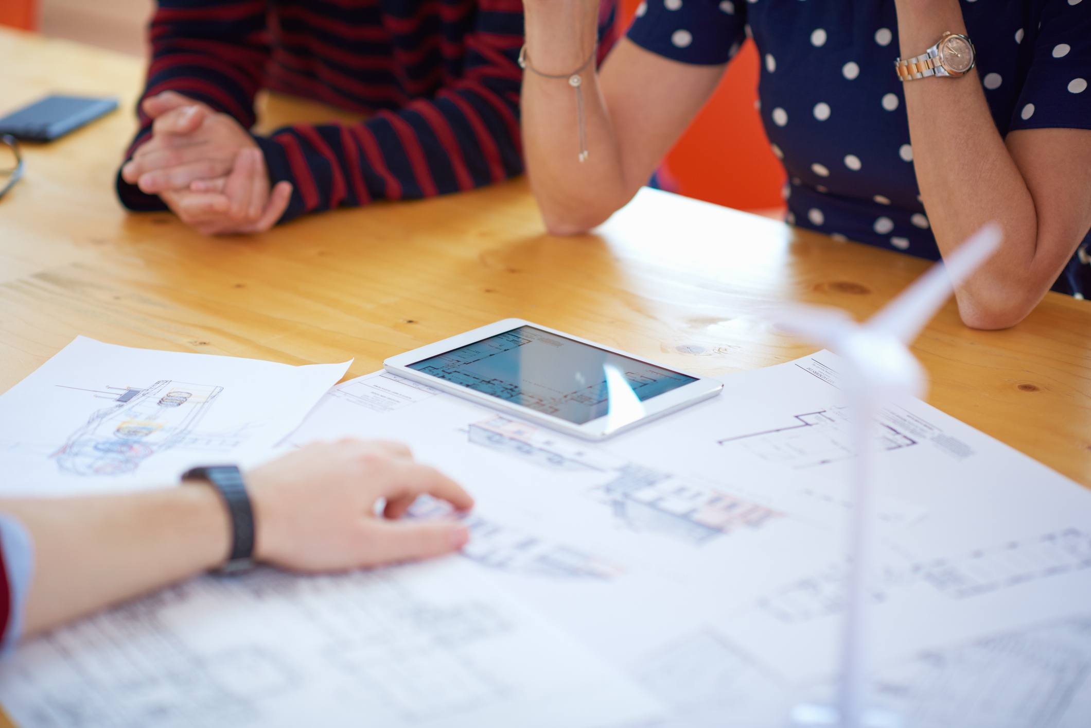 People around table looking at blueprints