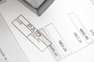 paid stamp on an invoice