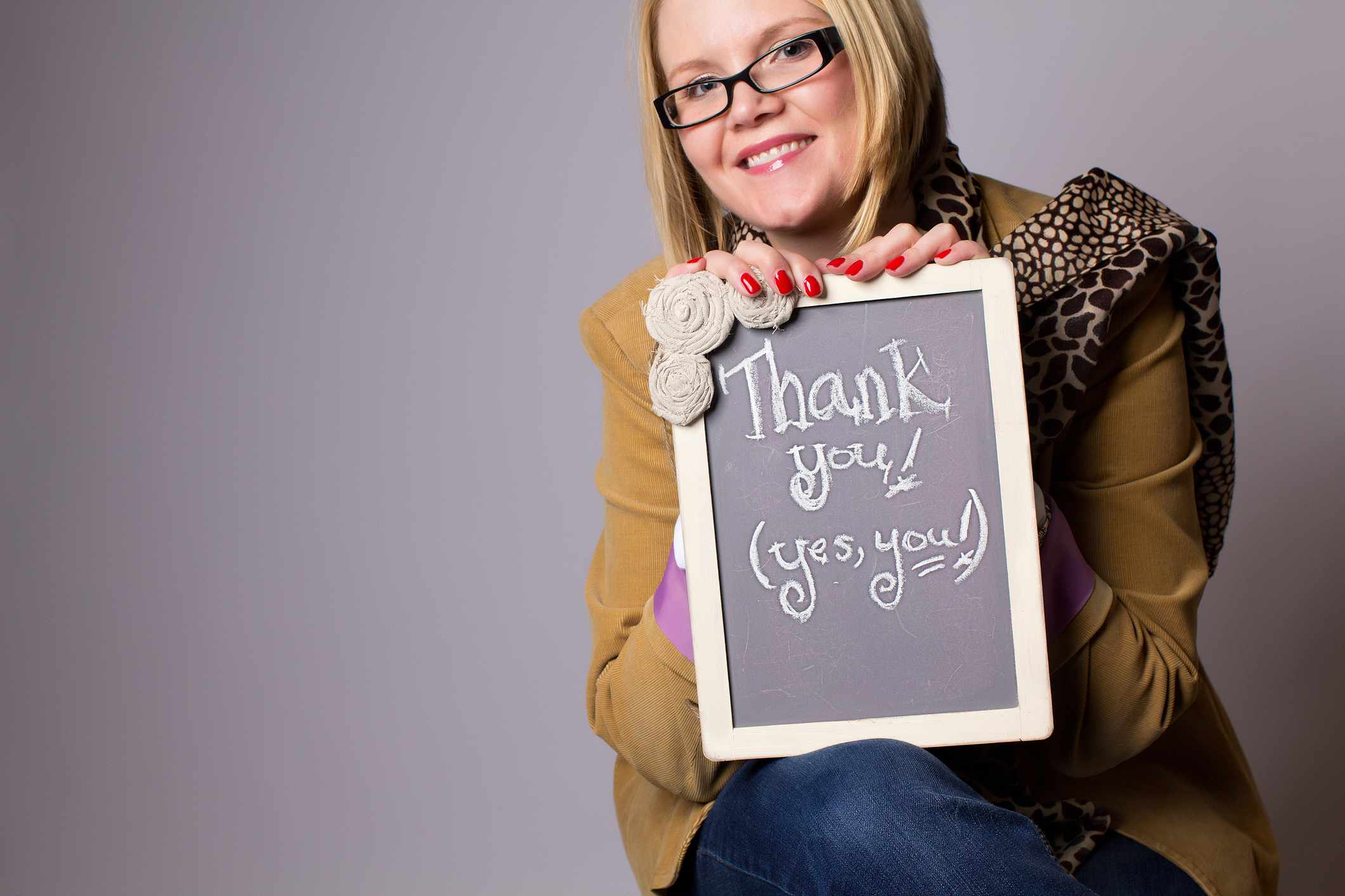 Woman holding a thank you sign.