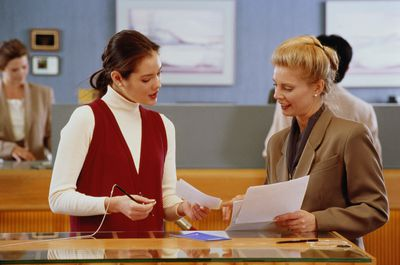 Woman discussing forms with bank executive