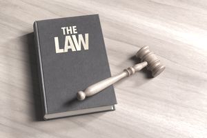 Close up of a gavel on an law book on wooden background
